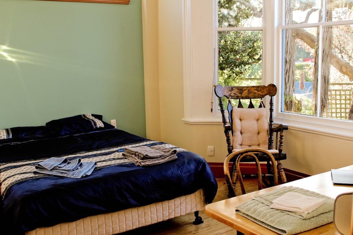 """Queen bed with fresh linen; Bay window """"Americana"""" rocker in your room"""