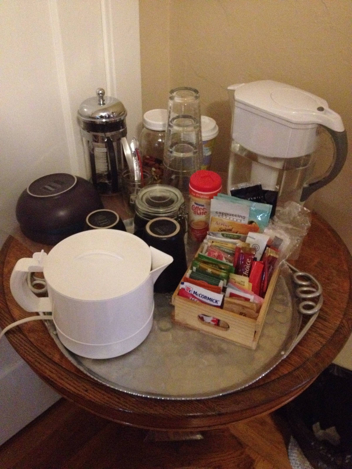 The room is equipped with coffee, tea, and seasonal goodies.