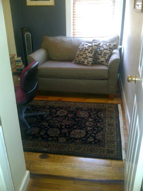 This is the side room, with Persian rug, is comfortable for hanging out. This twin-sofa bed pulls out.