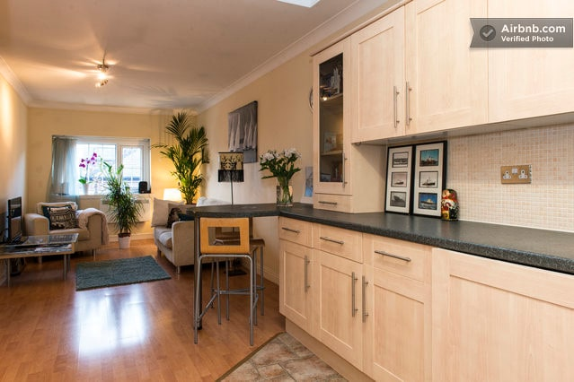 Kitchen joins the living area with a breakfast bar