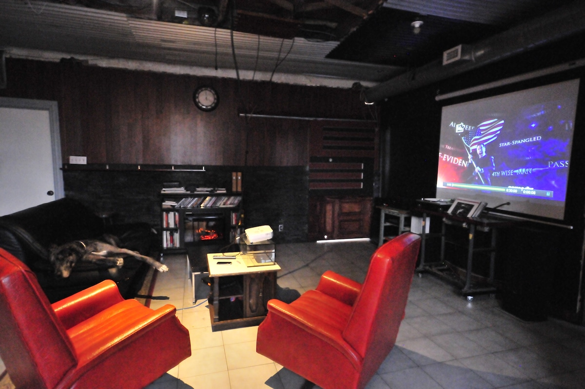kick back and watch a movie on the projector in the DARK room