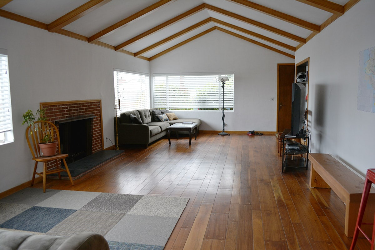 Bright and spacious living room, vaulted ceiling, couches and a view!