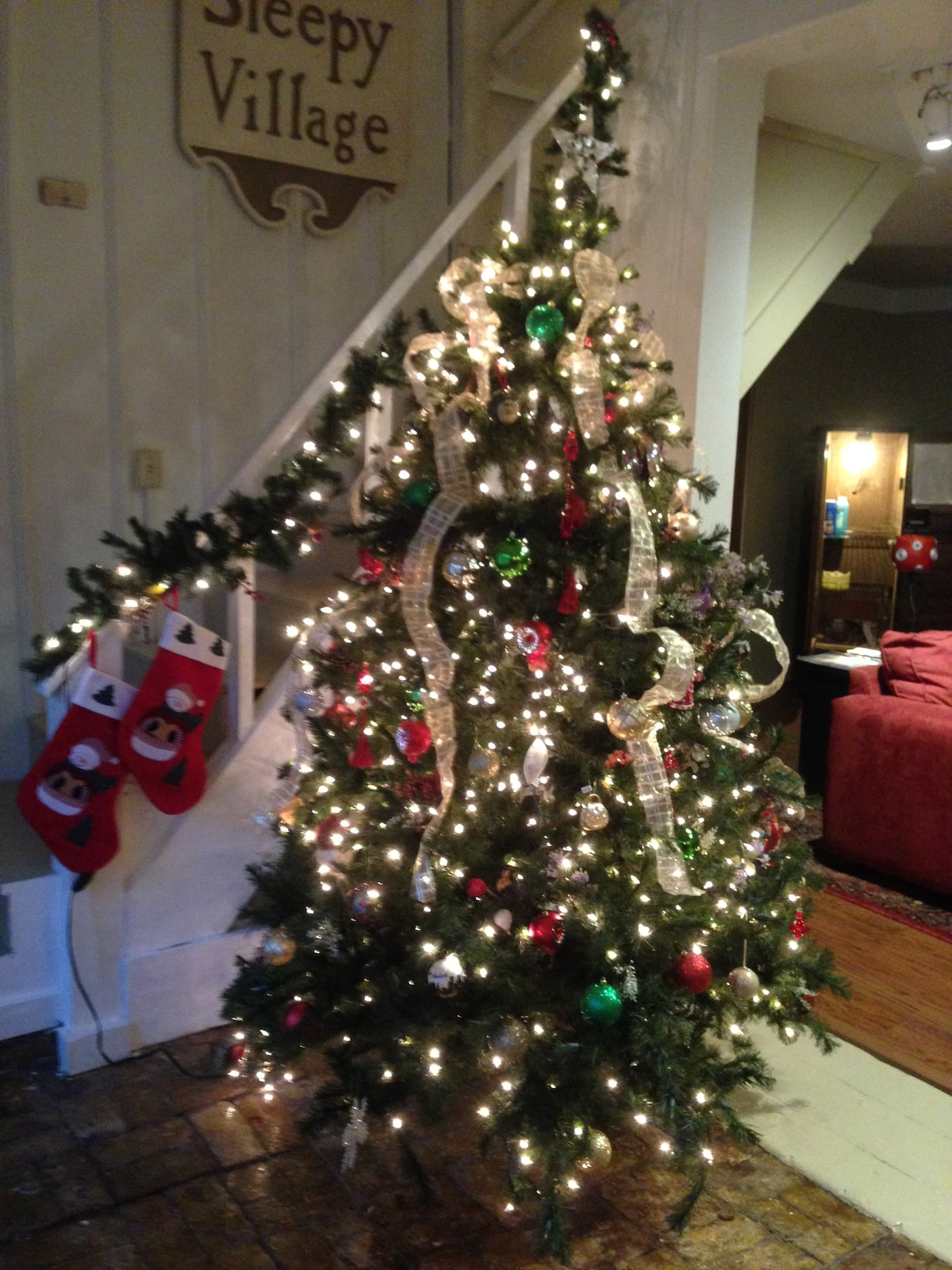 Christmas tree and stockings welcome guests