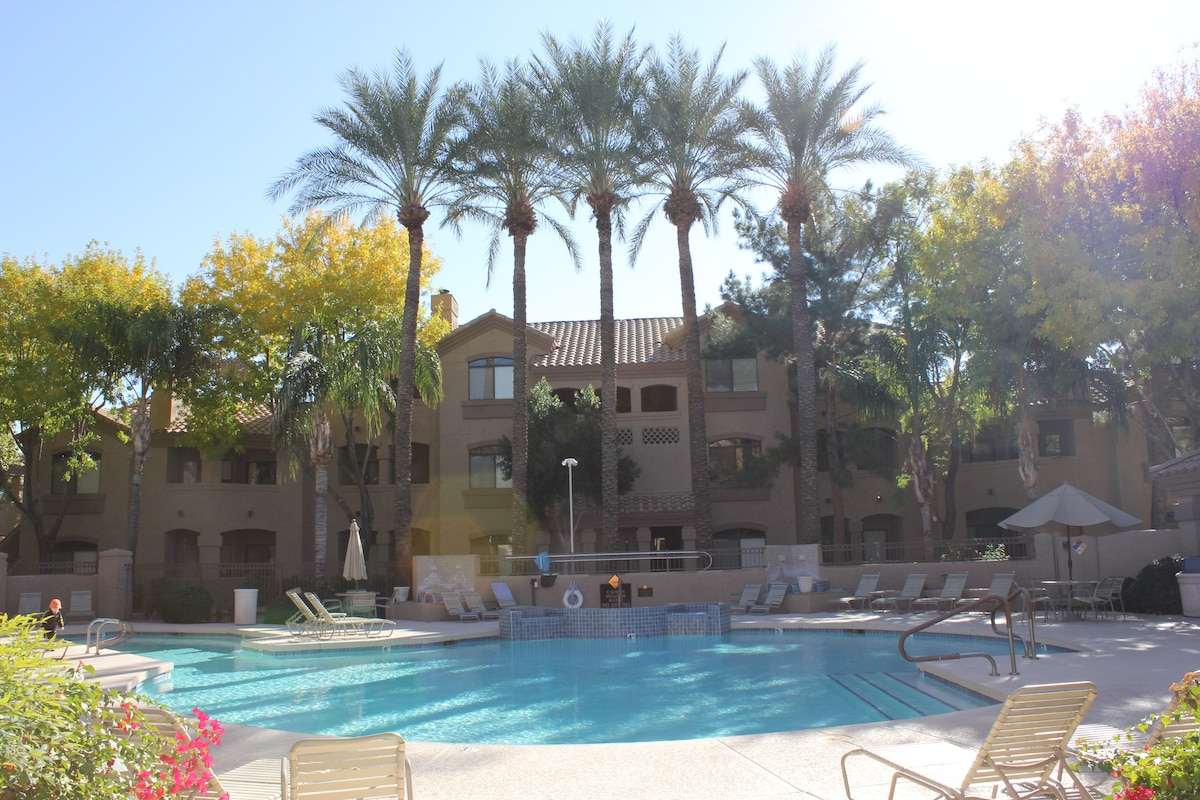 Main pool with hot tub attached to clubhouse and fitness center