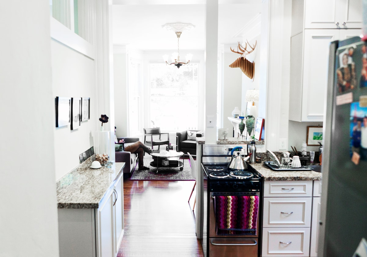 modern elements, mid century furniture and victorian trims living in perfect harmony