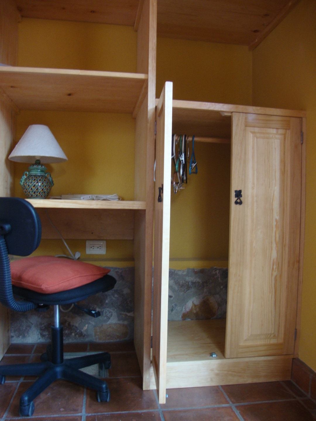 Built-in cabinet offers closet/desk/ shelves combo.