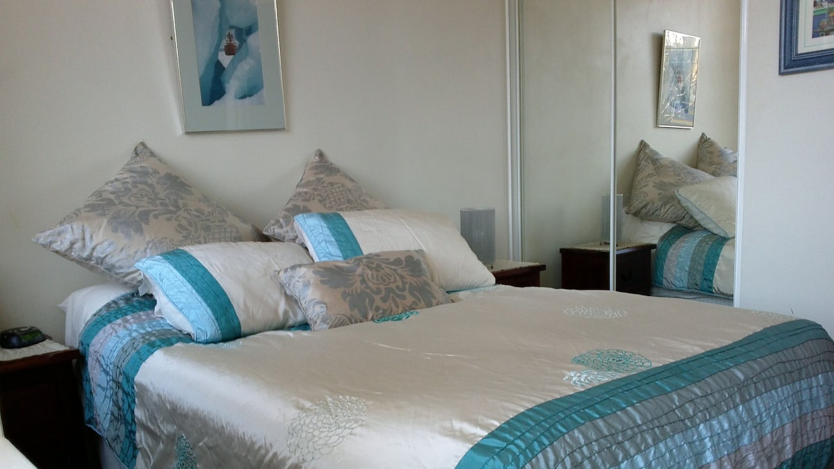 Comfortable, bright bedroom with luxury linen.