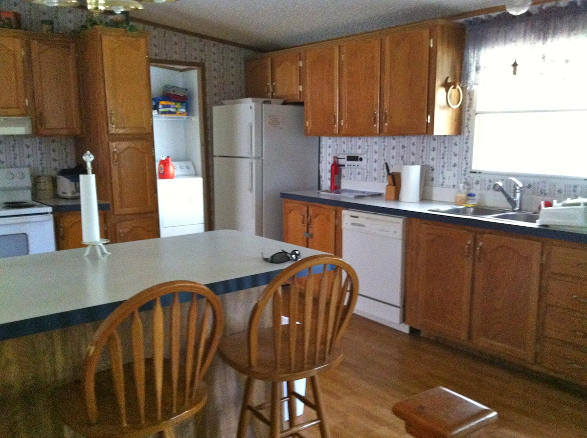 Fully equipped kitchen with full size fridge, oven, microwave and coffee maker.