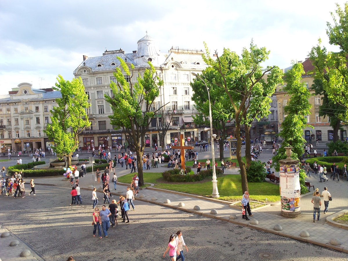 Your bedrooms view to the beginning of main Svobody Avenue on Lviv City Holiday. Late Spring, Summer or early Autumn - best time to visit & explore Lviv. New Year & Christmas time is fabulous. Rest of the time - there still lots of restaurants and clubs.