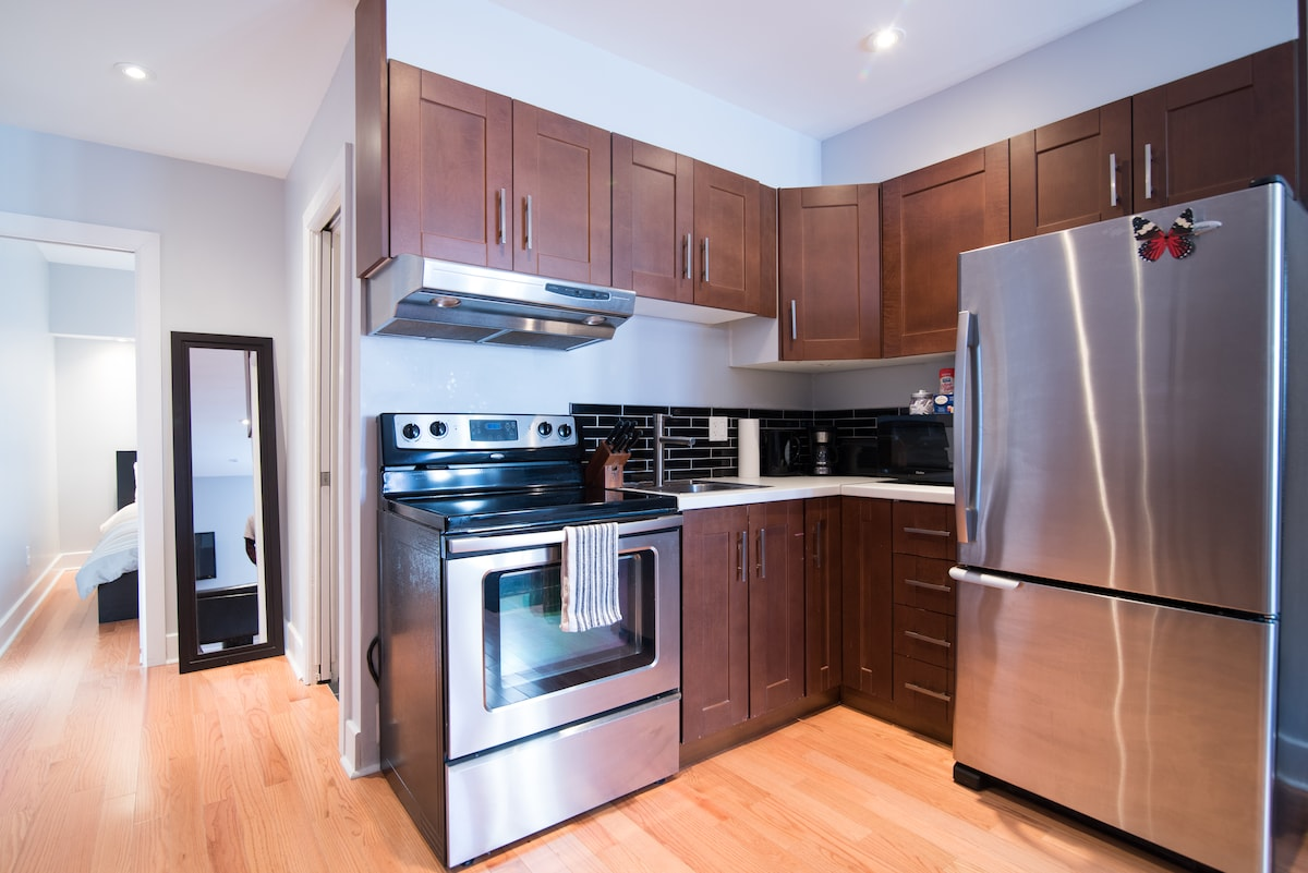 Modern Kitchen with glass tile back splash.