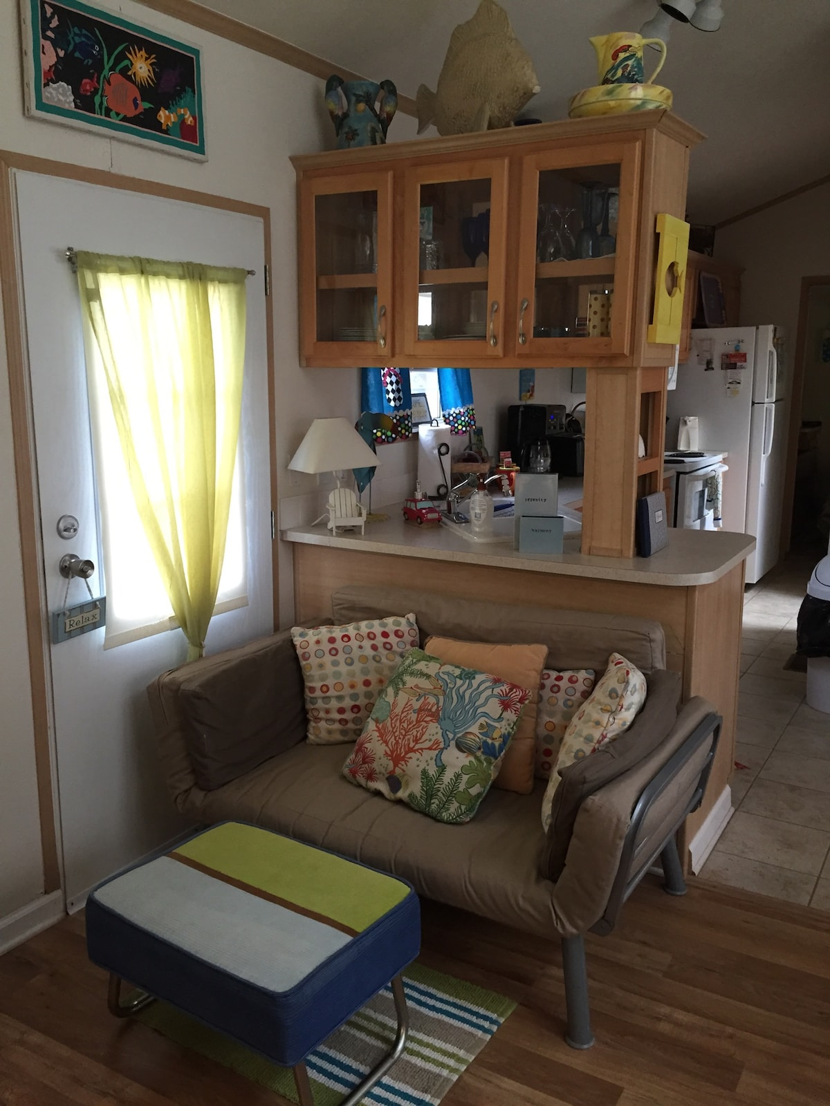 Fold out Futon.  Open cabinet space into the kitchen.