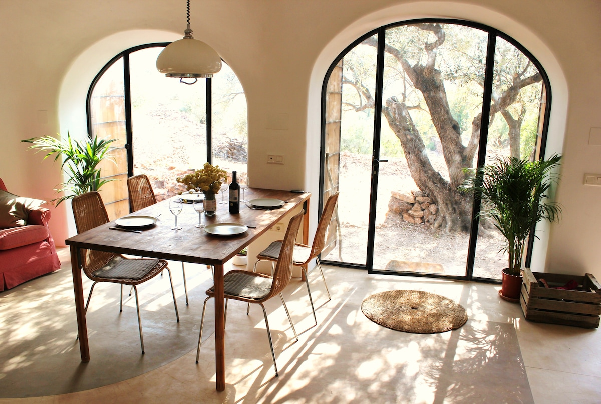 Dining area leading to front terrace.  Polished concrete floors keep you nice and cool.