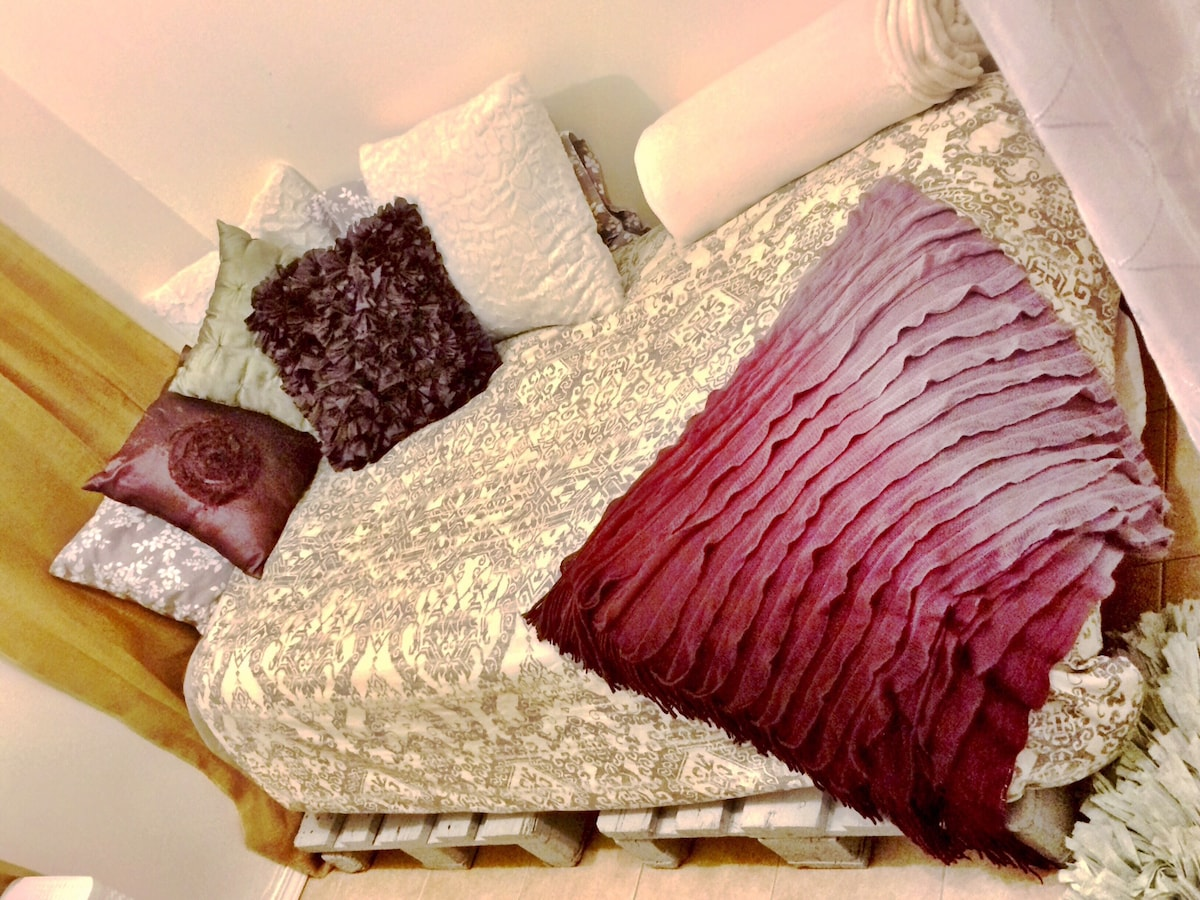 Very comfortable pallet bed/ day bed.