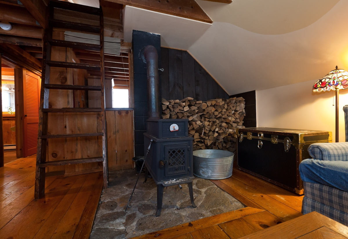 a very efficient wood stove, also the ladder to bedroom in loft