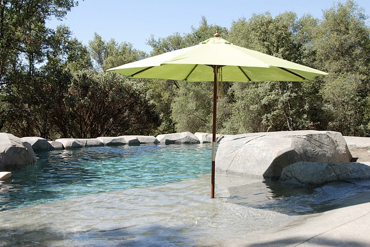 "Our extraordinary artisan pool even has a little ""beach.""  You can sit under this umbrella with your feet in the water! Wonderfully refreshing  on  hot Mariposa days!"