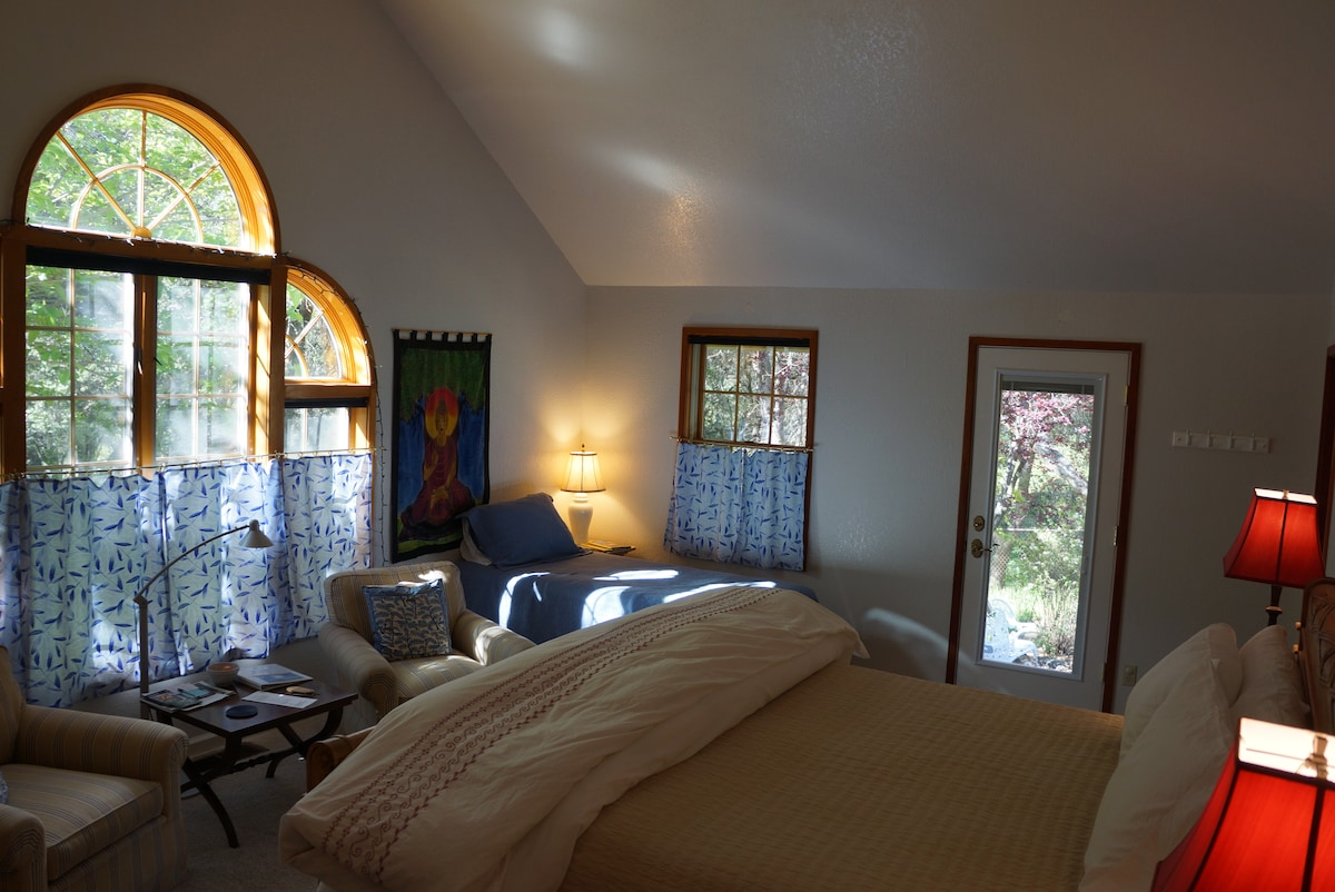 Room 1  has beautiful arched windows, a cathedral ceiling with a fan and its own private  entrance to its own little patio.