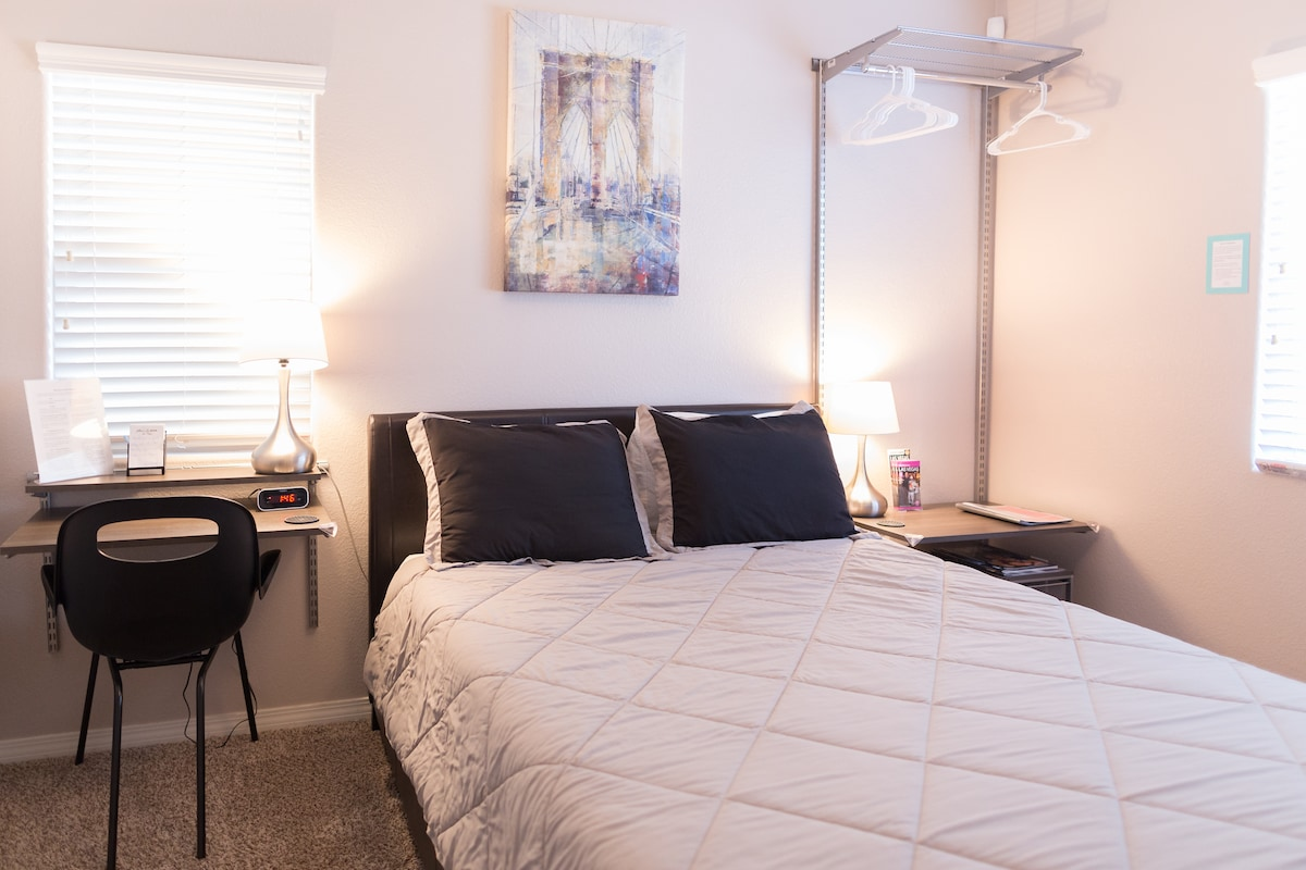 """East Room"" - Your private 1st floor bedroom adjacent to the living room, includes queen bed, desk, sofa/twin bed, 32in TV, cable, DVD player, and Roku with complimentary access to my Netflix account"