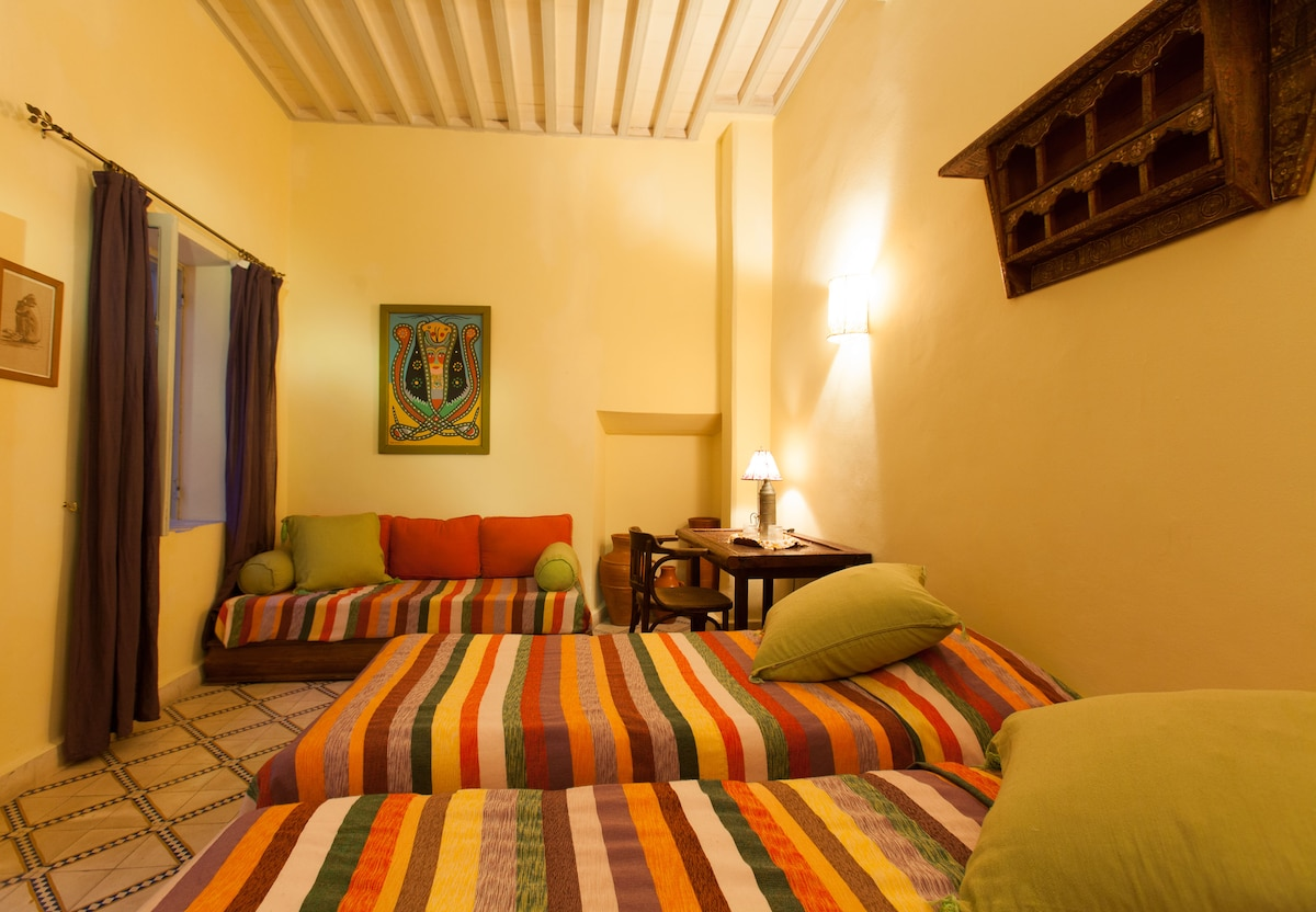 triple room in riad with a sea view