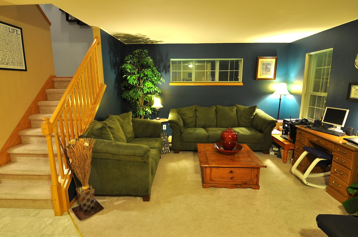 Front Sitting Room.   Couches can sleep 1, maybe 2.  Floor space for air mattress if needed.