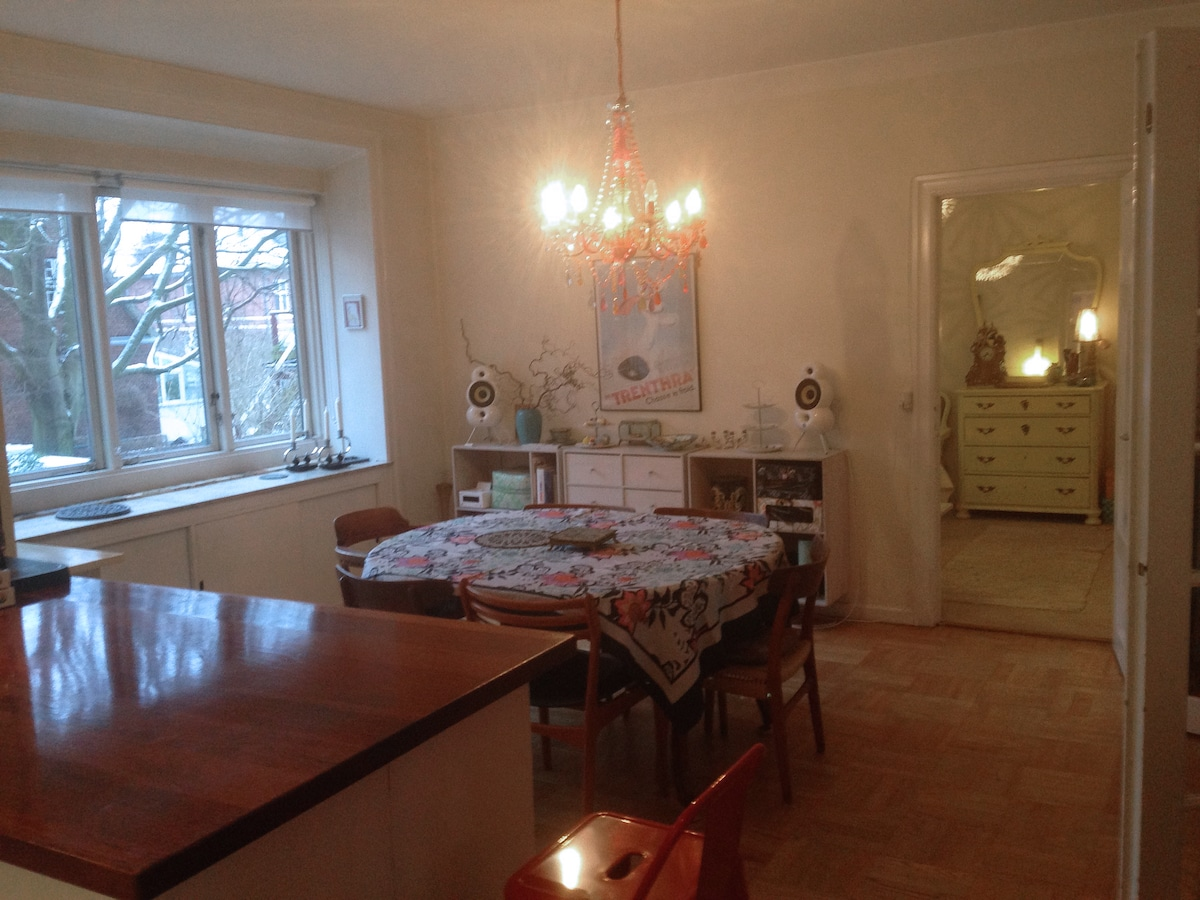 Kitchen/ dining area View into bedroom