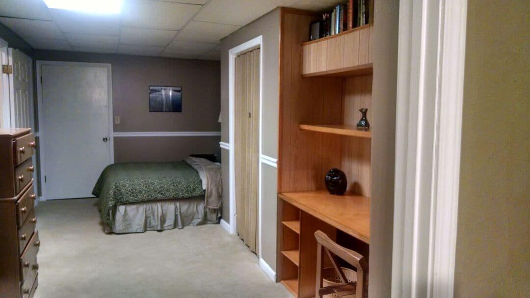 Basement suite's double bed has new linens, Egyptian cotton sheets.