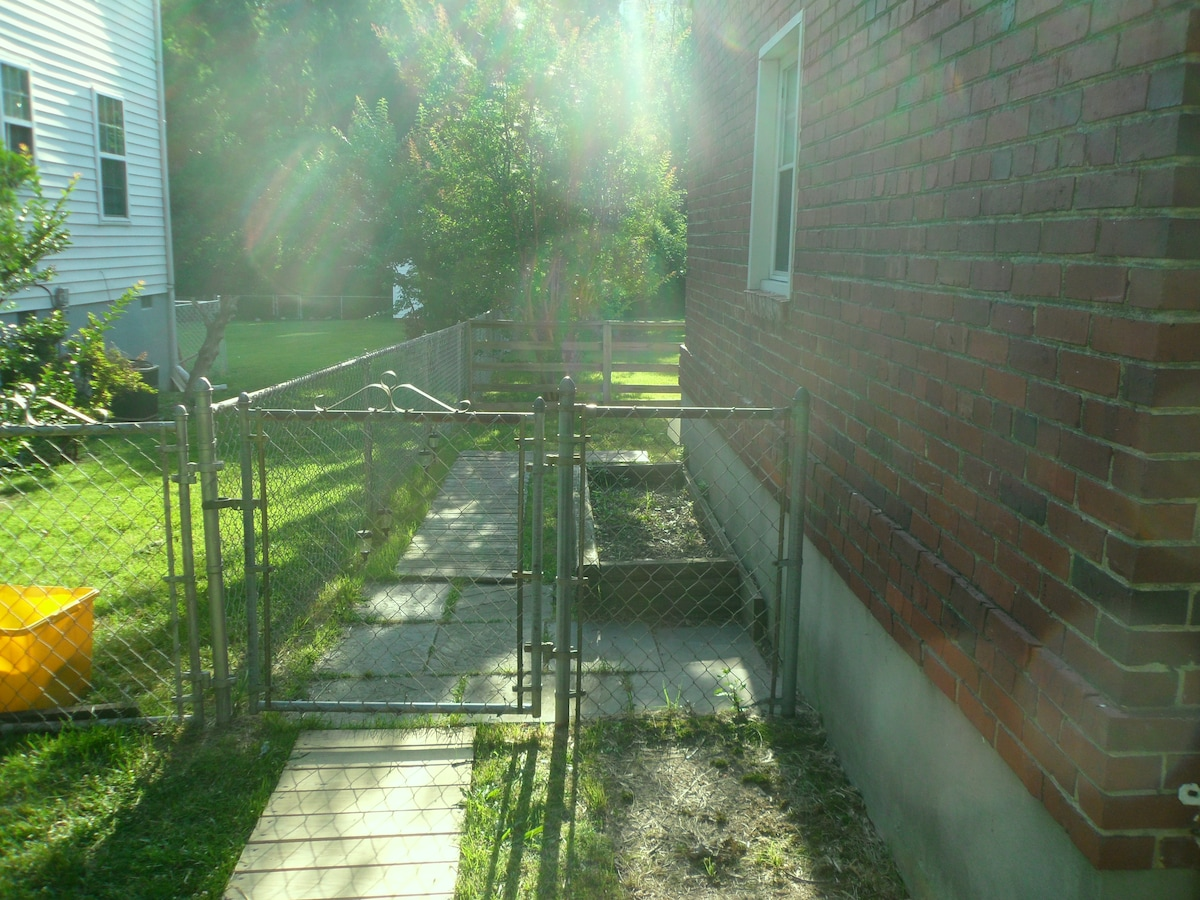 Entrance way to the 2 bedroom no frills private condo suite.  Continue to walk this way through the gate..