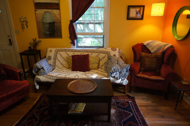 Cozy living room with fold out futon couch.