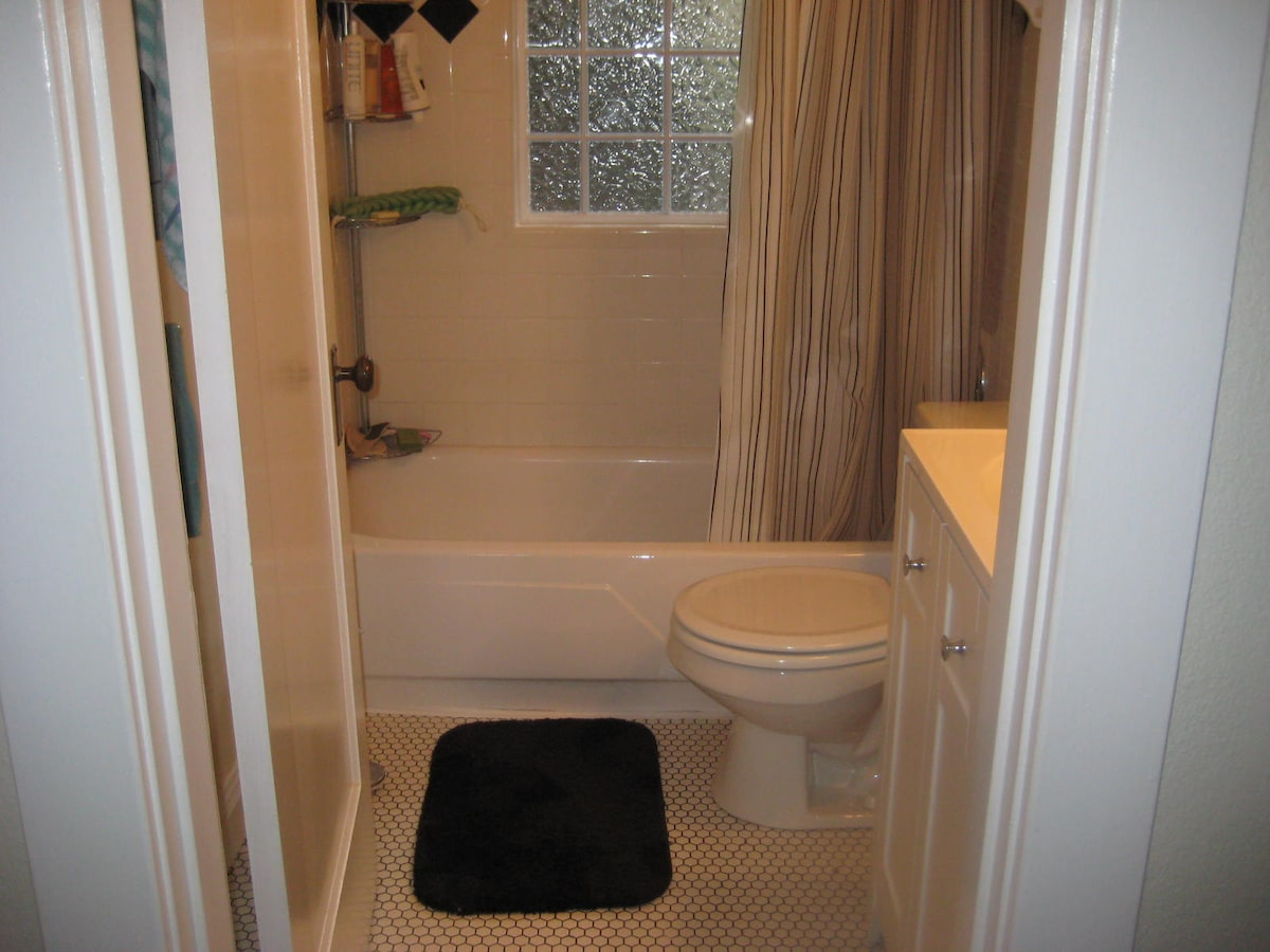 bathroom in hall next to bedroom