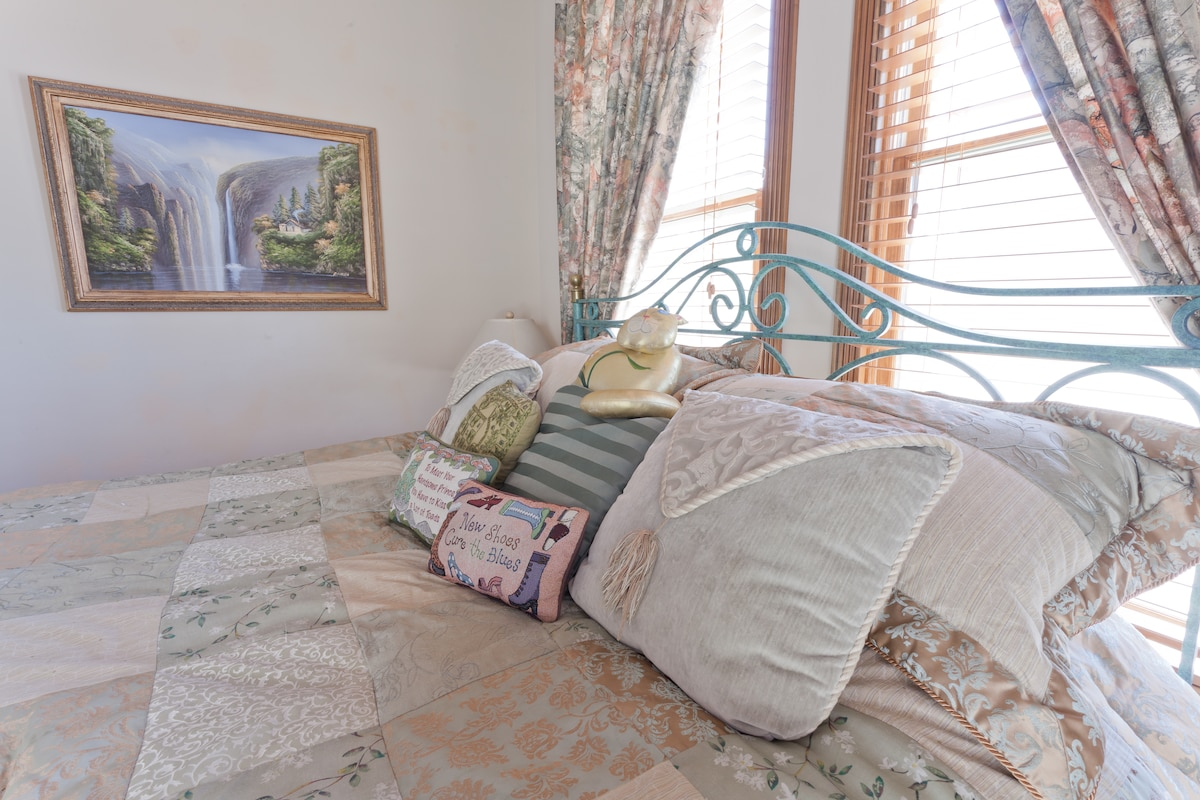 California Kings Size bed with down comforter and pillows.