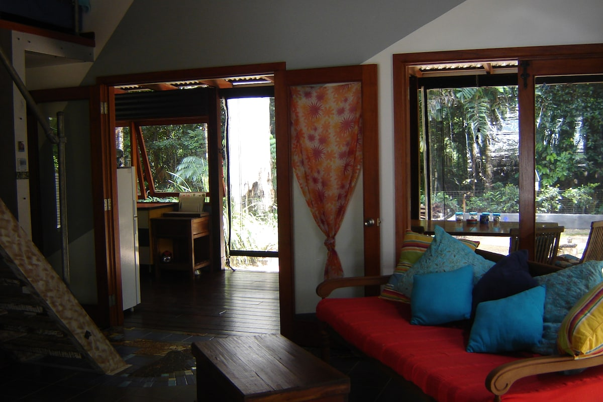 Moo Bay lounge area leading out to kitchen and dining room.  We leave all the doors open so that the forest comes to life in the house