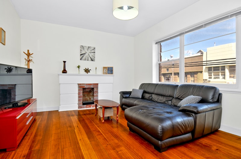 """Living area with leather sofa and 50"""" Flatscreen TV"""