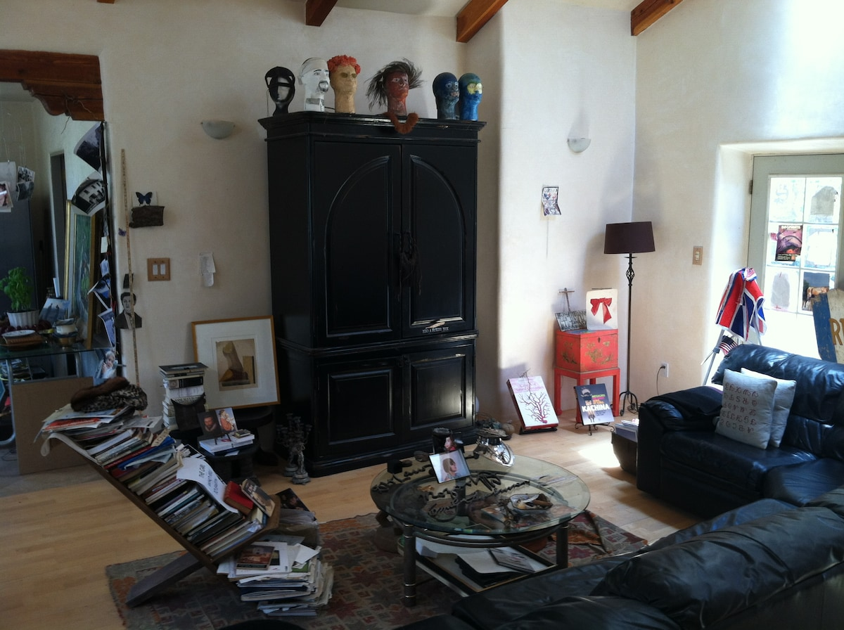 Part of living room. (Television inside black chest, no cable, DVD player only)