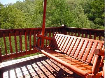 Relax on the porch swing and listen to the train whistle from Dollywood