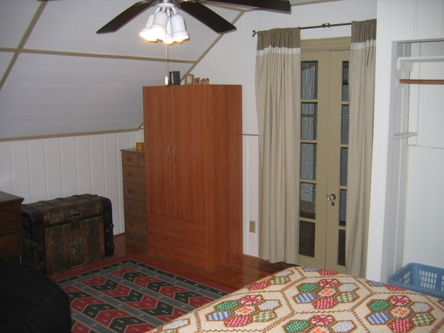 Armoie and chest of drawers next to entrance (French doors with drapes)