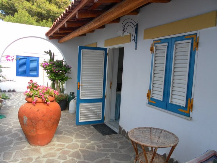 an appartement for two people, in the background a 4 people house
