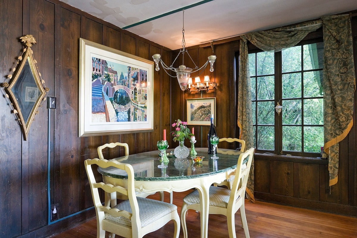 Original redwood wall living room and dining table