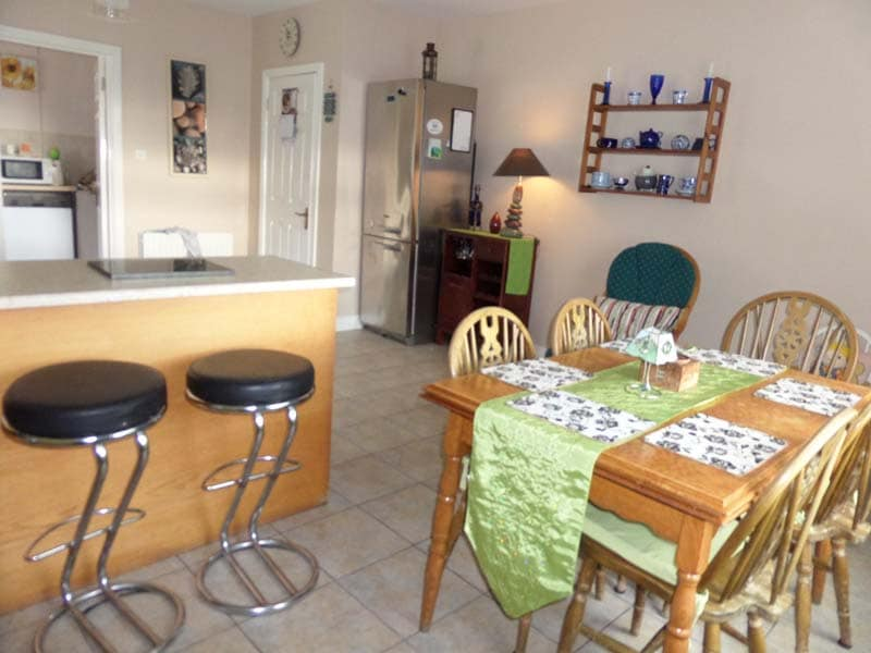 Fully equipped kitchen with large stainless steel fridge-freezer, double cooker, microwave, cooker