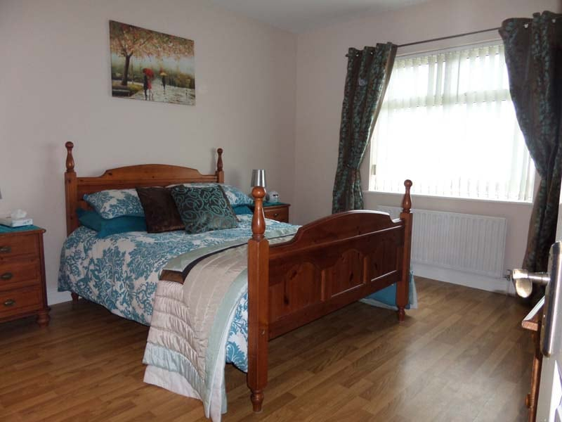 Master bedroom with superb views of the the garden, river Foyle and the NI Coastline