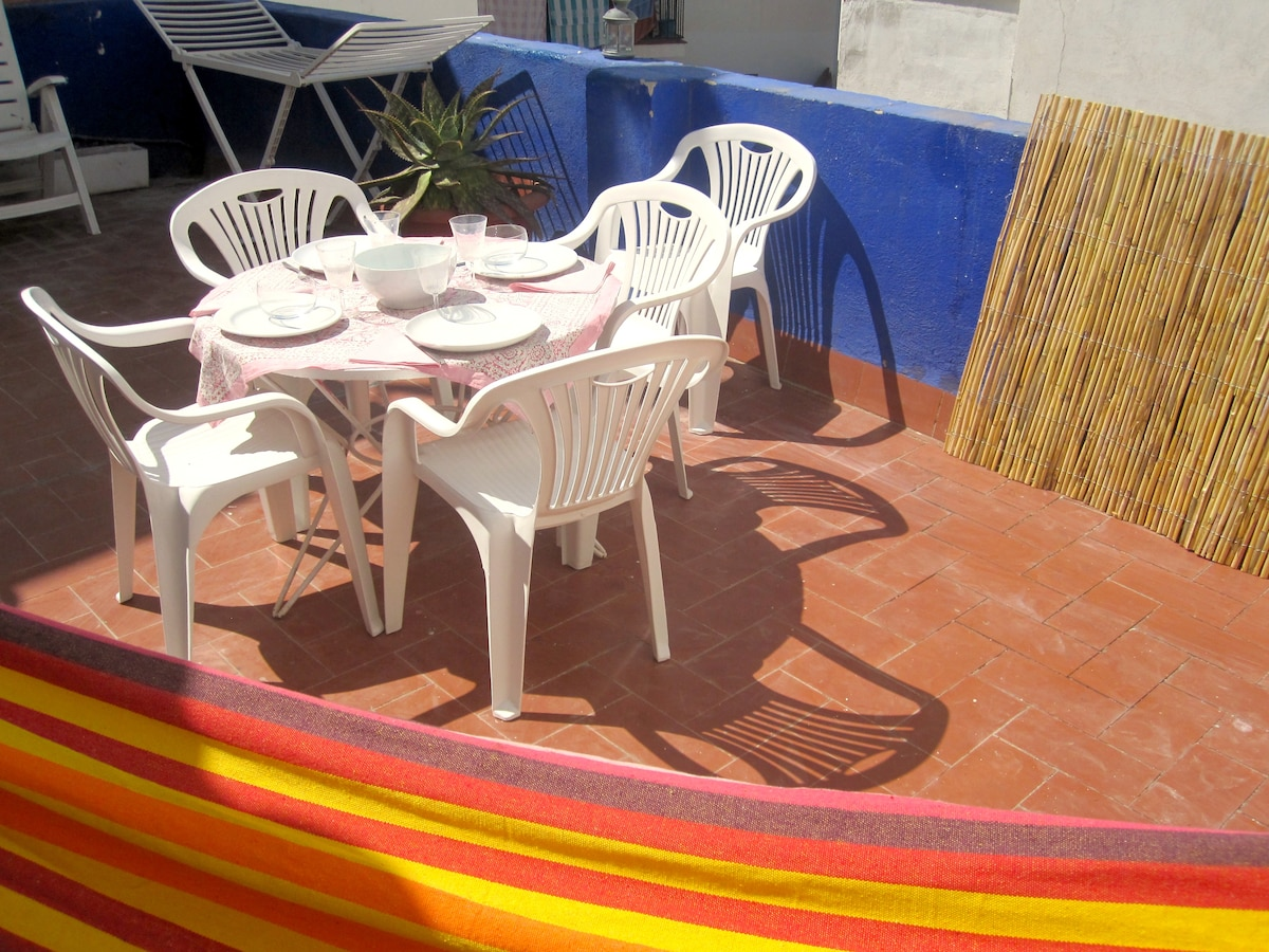 The terrace offers a great space for lazing in the hammock, dining and sunbathing
