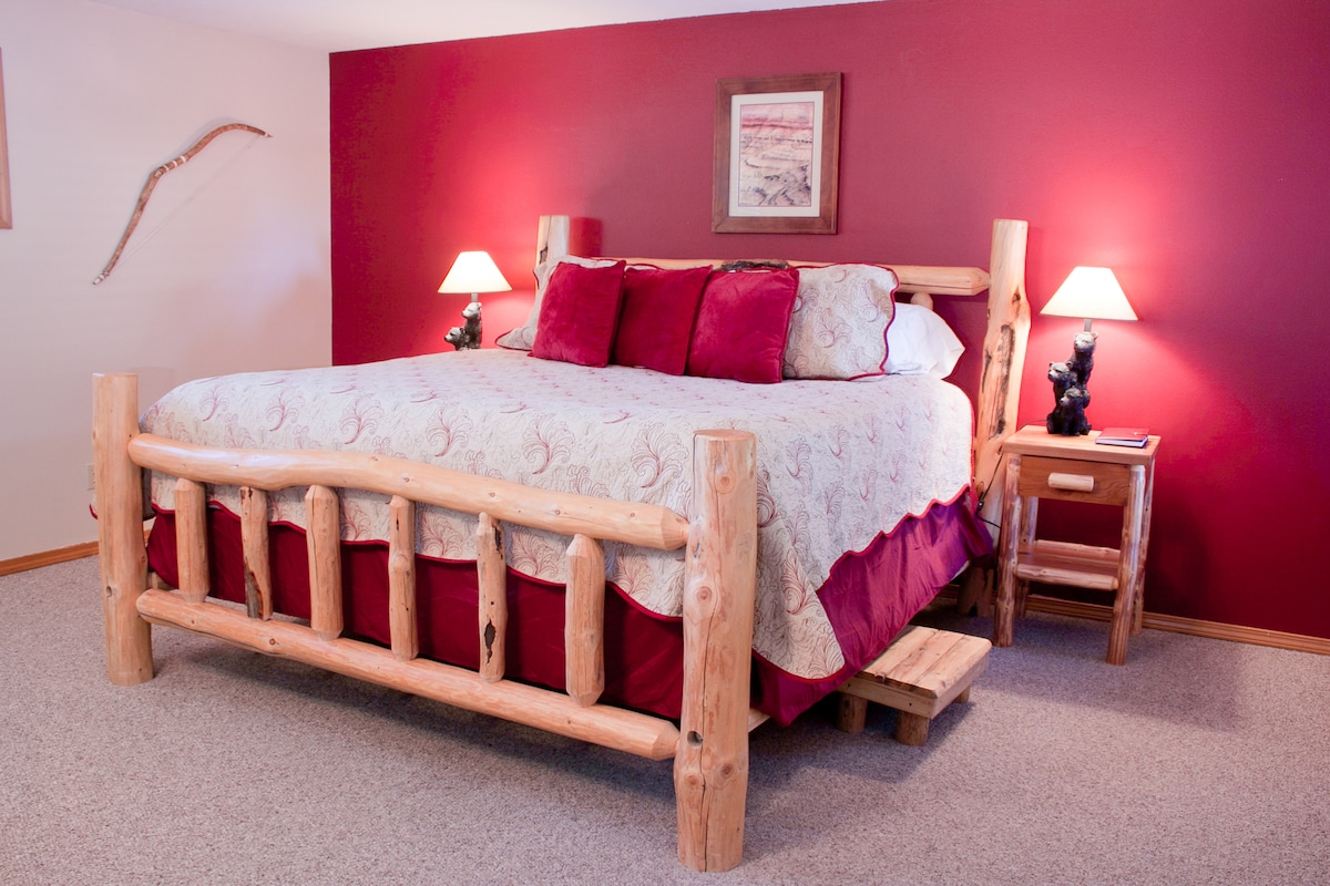 Another view of bed showing the step stool for you to climb into luxury.