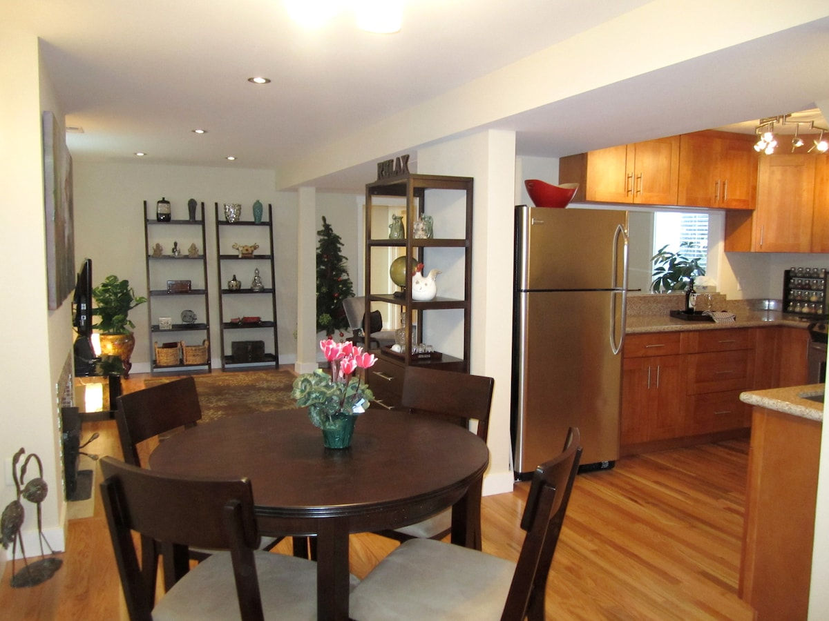 Dining table for four opens to kitchen and living room