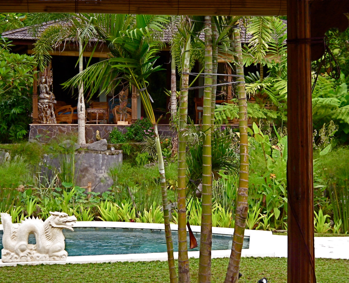View from Mermaid Pavilion over the pool and lotus pond toward the Villa Delicious.