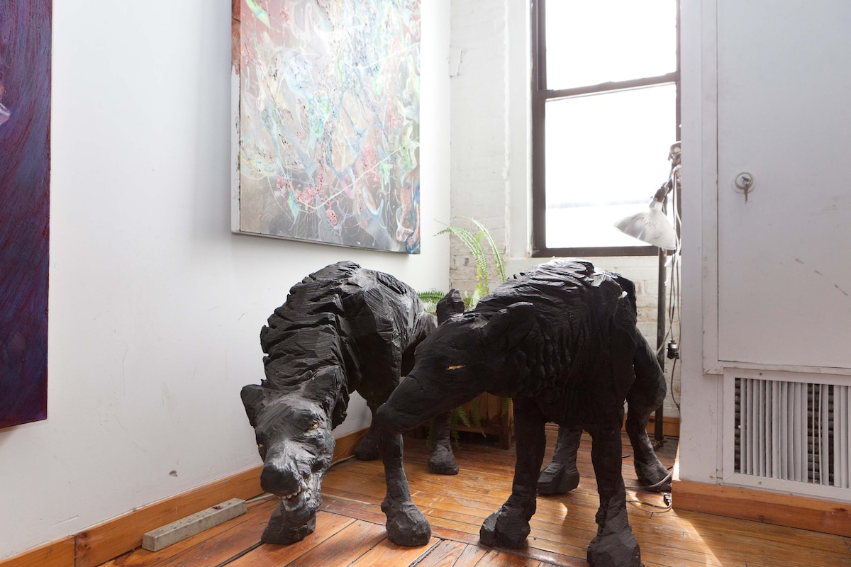 Our guardian dogs: wooden wolves sculpted with chain saw by artist friend.