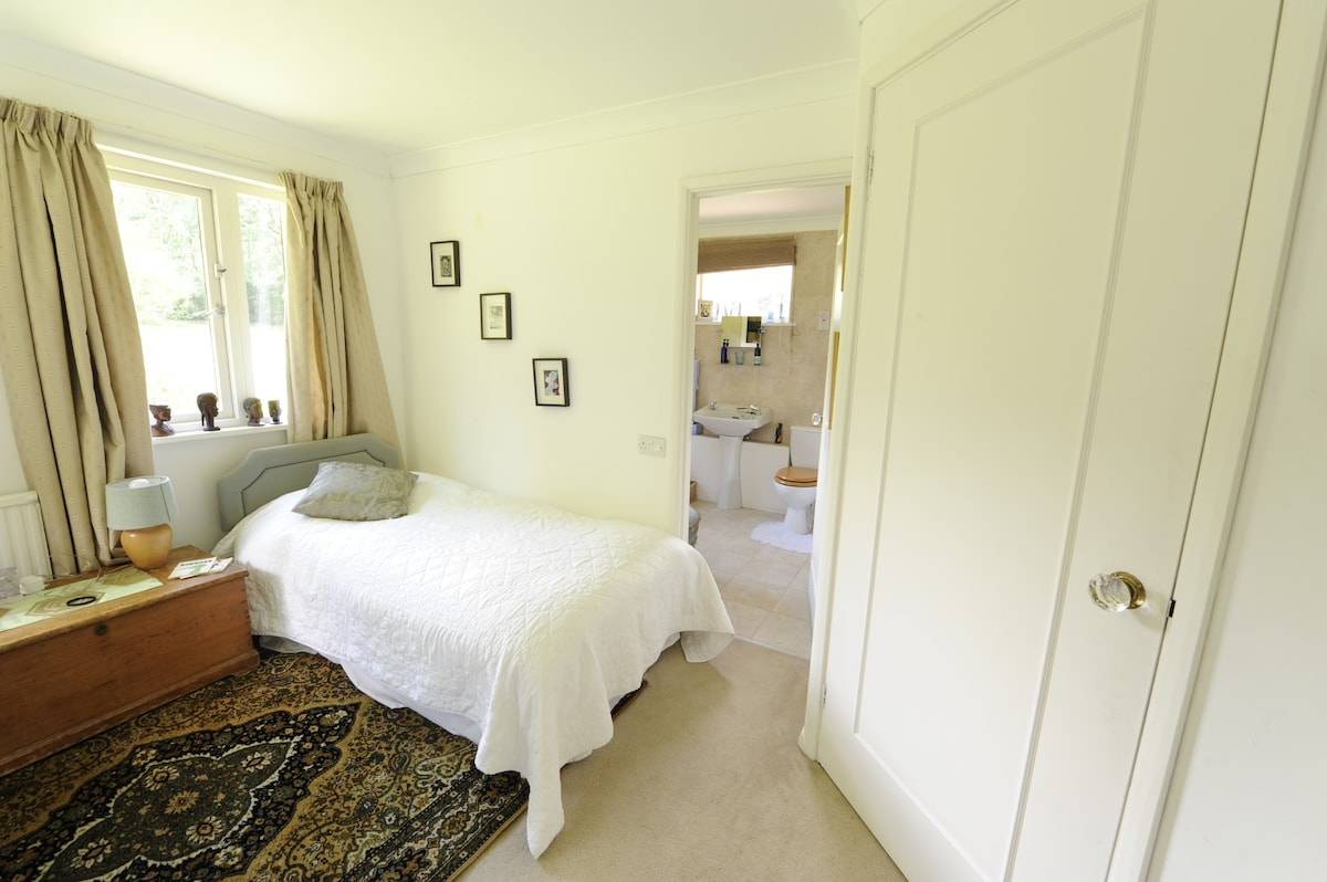 The Twin Bedded Room looking through the door to the ensuite bathroom.