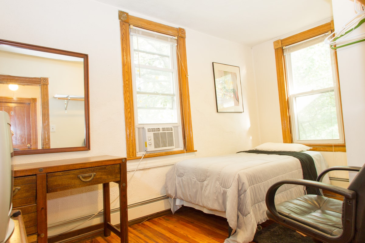 Upstairs bedroom with twin sized bed, suitable for one person. This is not a large room.