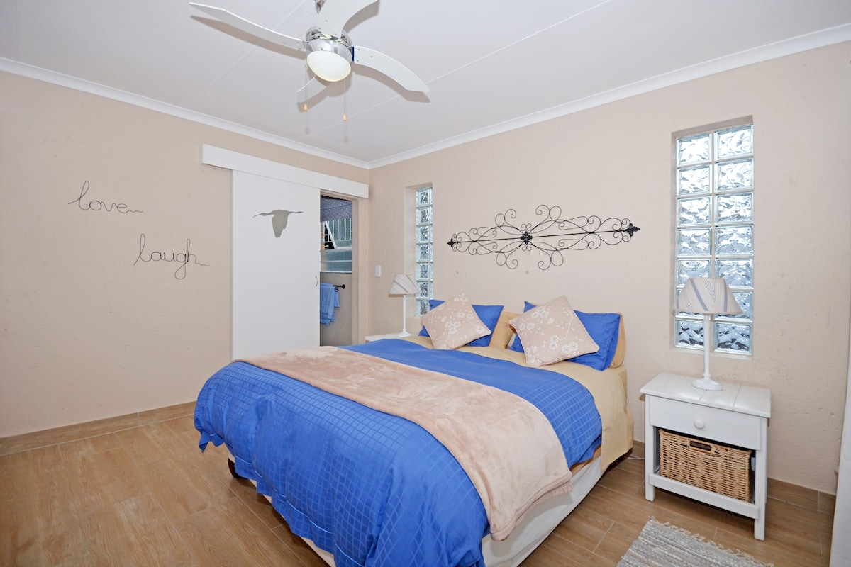 Another view of the bedroom with bathroom in the background