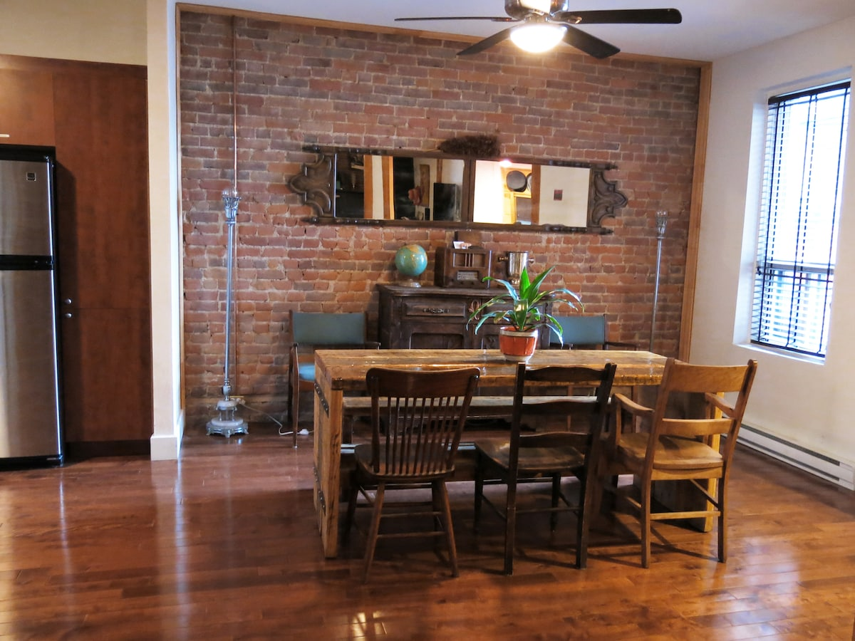 handmade table seats 6!  open concept living room/dining room/kitchen.