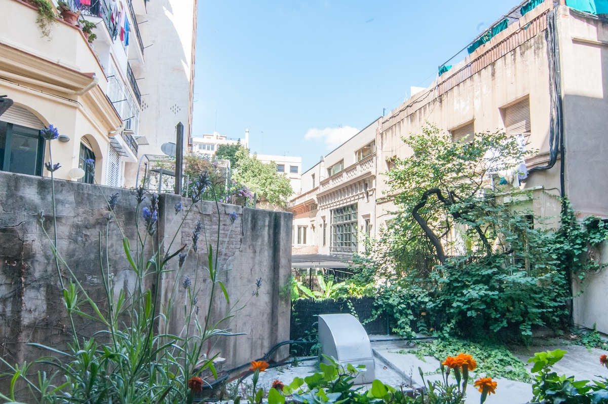 view to lovely quiet internal gardens overlooking chic restaurants with lovely outside dining.