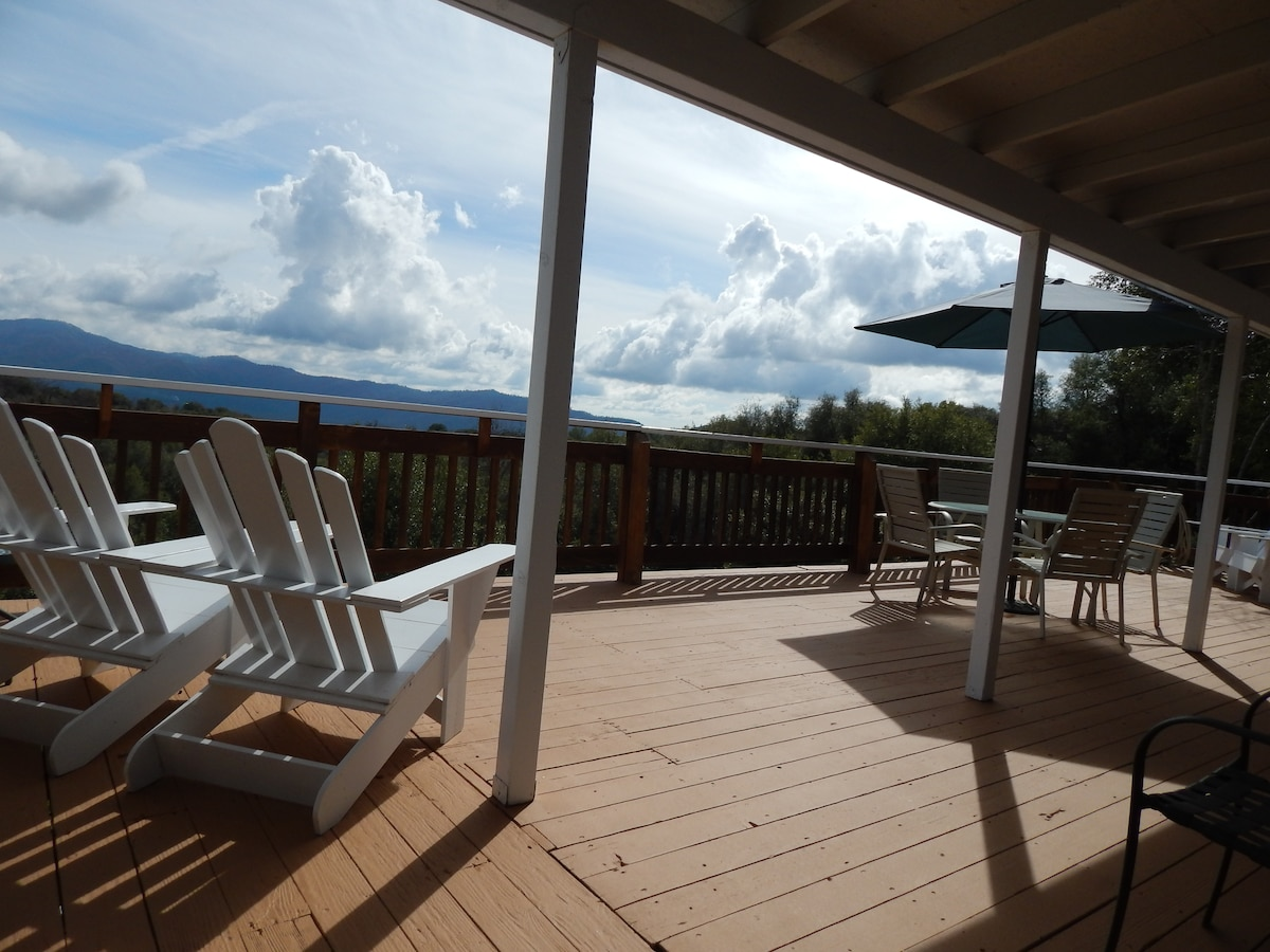 Deck offers additional dining table for four and two Adirondack chairs.