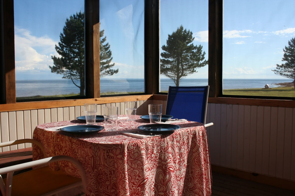 screened-in-porch with seating for five and beautiful views of our beach